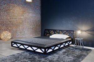 Design bed Nest in massief geolied hout